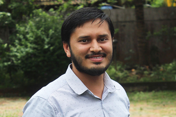 portrait of Aseem Nishad checkworkrights team member